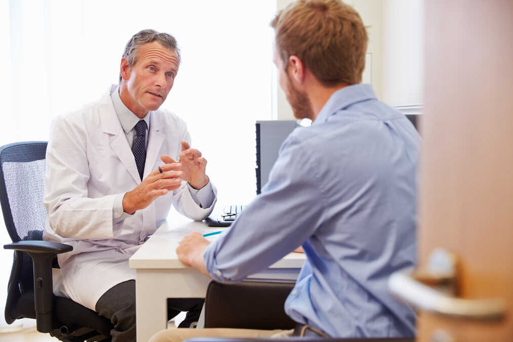 Male Patient Having Consultation With Lasik Doctor In Office