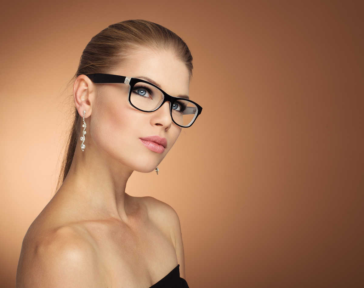 woman with glasses wondering about the differences between LASIK procedures
