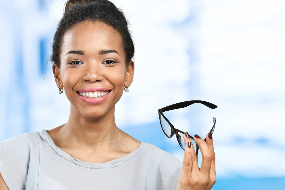 woman who is keeping her glasses around in case her LASIK doesn't last forever